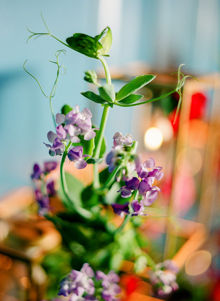 purple wedding flowers - photo by Lisa Blume Photography http://ruffledblog.com/runway-to-table-wedding-inspiration-with-bows