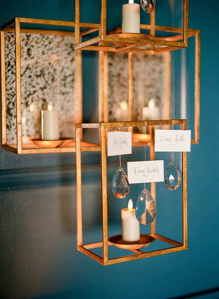 unique geometric seating charts - photo by Lisa Blume Photography https://ruffledblog.com/runway-to-table-wedding-inspiration-with-bows