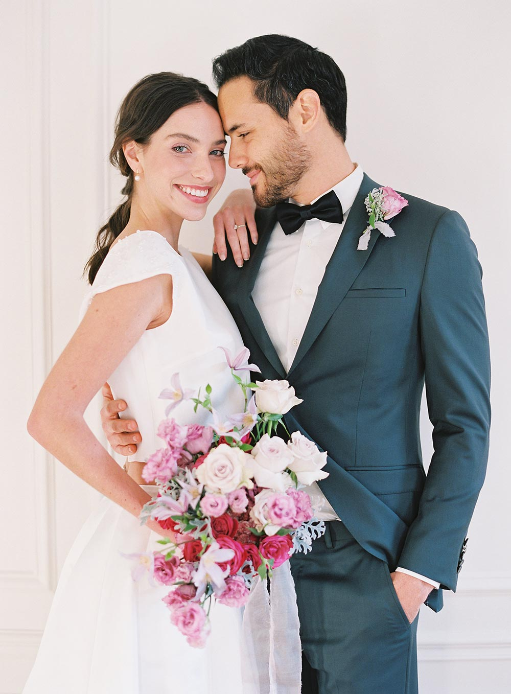 two piece bridal gown with charcoal groom suit