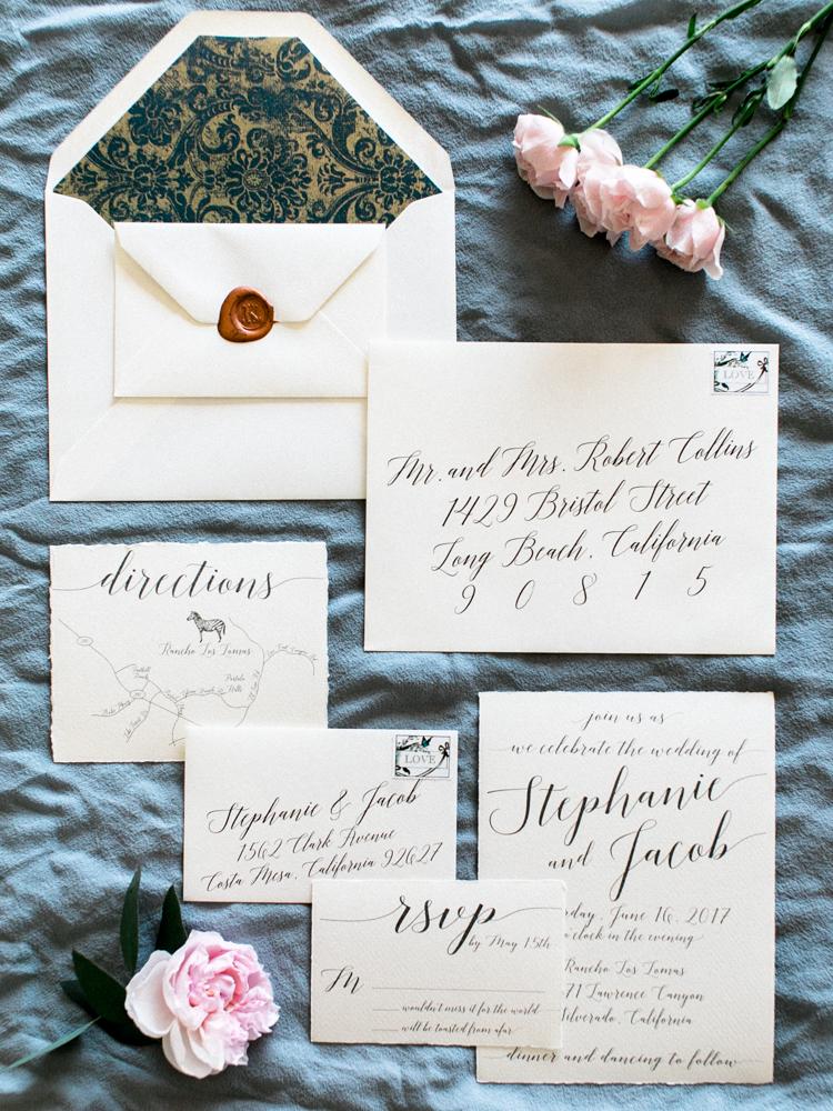 classic wedding invitations - photo by Dennis Roy Coronel http://ruffledblog.com/copper-blue-rancho-las-lomas-wedding-inspiration
