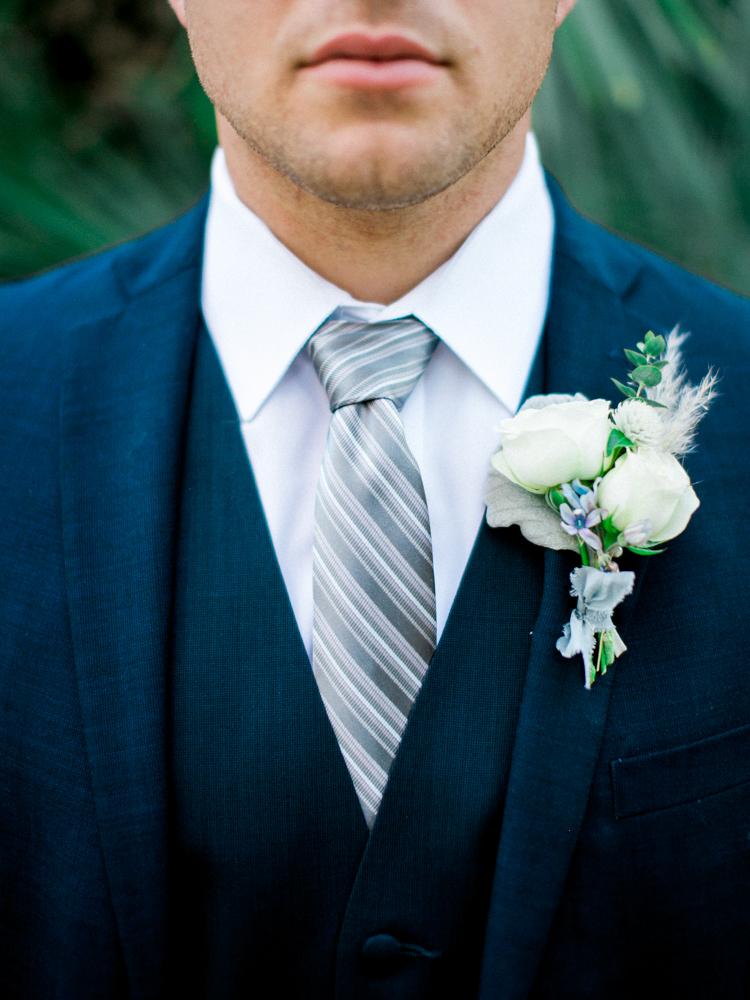 groom boutonnieres - photo by Dennis Roy Coronel http://ruffledblog.com/copper-blue-rancho-las-lomas-wedding-inspiration