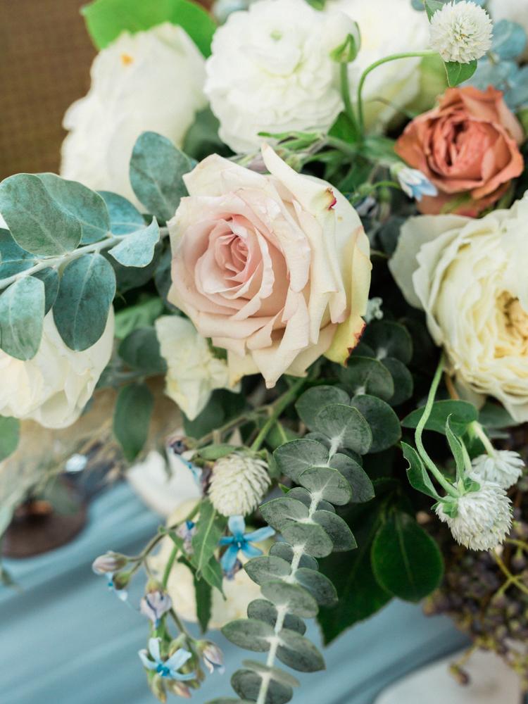 eucalyptus centerpieces - photo by Dennis Roy Coronel http://ruffledblog.com/copper-blue-rancho-las-lomas-wedding-inspiration