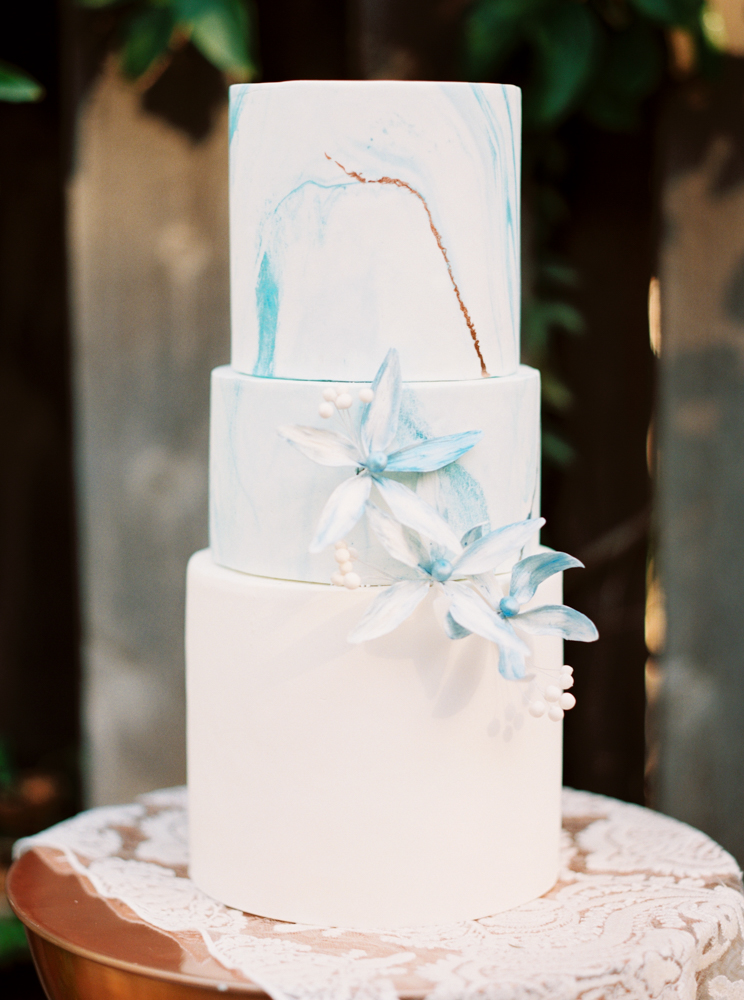blue marbled wedding cakes - photo by Dennis Roy Coronel http://ruffledblog.com/copper-blue-rancho-las-lomas-wedding-inspiration
