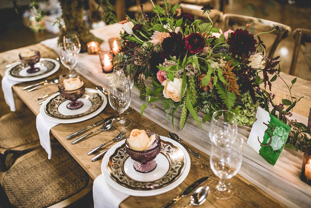 fall wedding table with purple accents - https://ruffledblog.com/rustic-woodland-chic-wedding-inspiration-in-baltimore