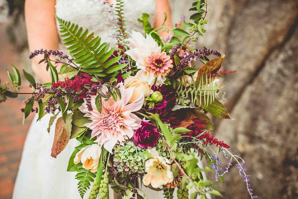 dahlia bouquets with ferns - https://ruffledblog.com/rustic-woodland-chic-wedding-inspiration-in-baltimore