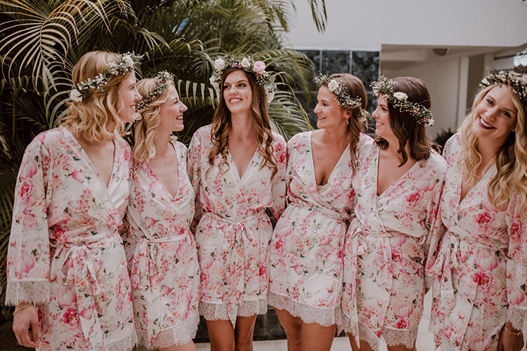 bridesmaids in pink floral robes - https://ruffledblog.com/costa-rica-beach-wedding-with-a-cute-bridesmaid-first-look