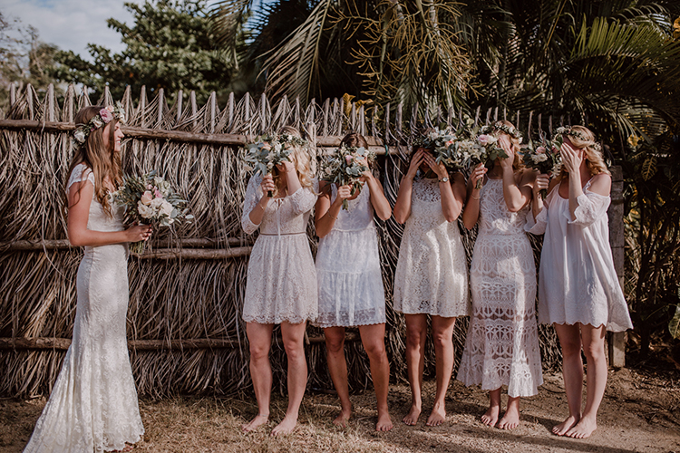 bridesmaid first looks - https://ruffledblog.com/costa-rica-beach-wedding-with-a-cute-bridesmaid-first-look