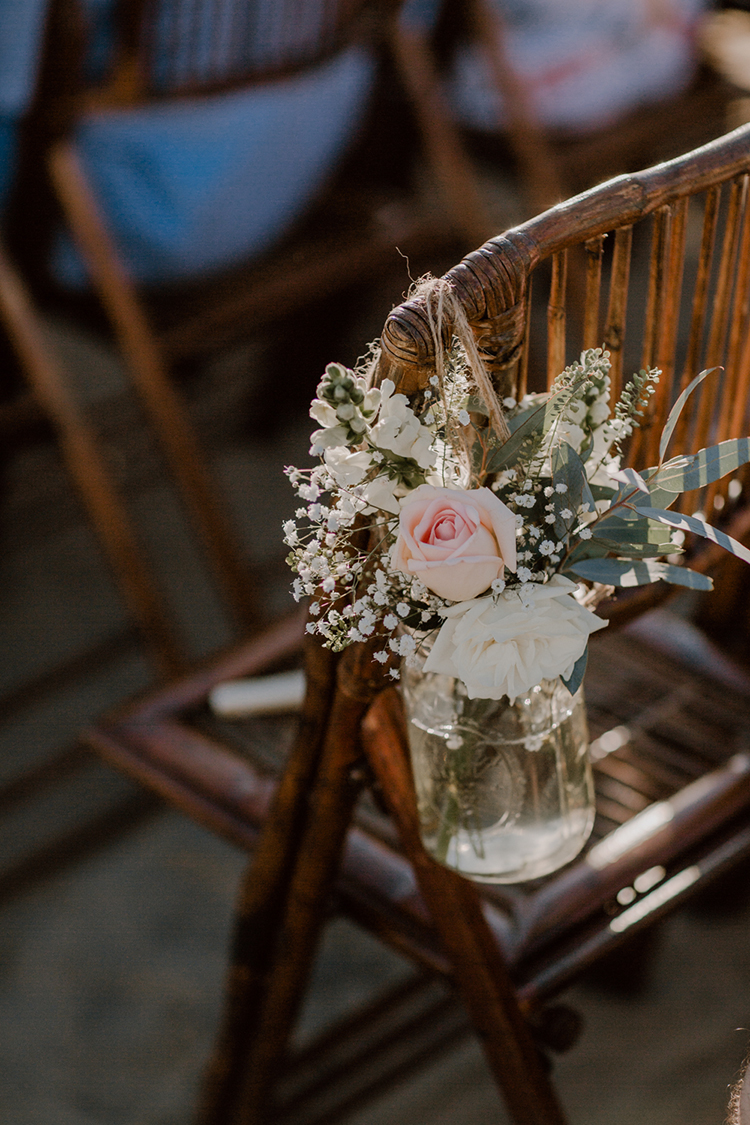 wedding ceremony chair decor - https://ruffledblog.com/costa-rica-beach-wedding-with-a-cute-bridesmaid-first-look