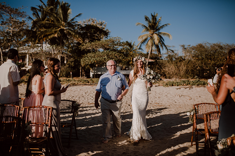 ceremony processionals - https://ruffledblog.com/costa-rica-beach-wedding-with-a-cute-bridesmaid-first-look