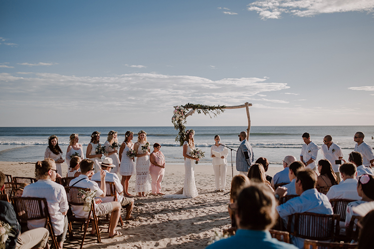 beach wedding ceremonies - https://ruffledblog.com/costa-rica-beach-wedding-with-a-cute-bridesmaid-first-look