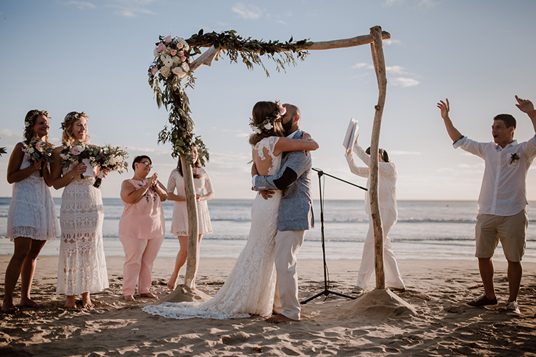 ceremony kiss - https://ruffledblog.com/costa-rica-beach-wedding-with-a-cute-bridesmaid-first-look