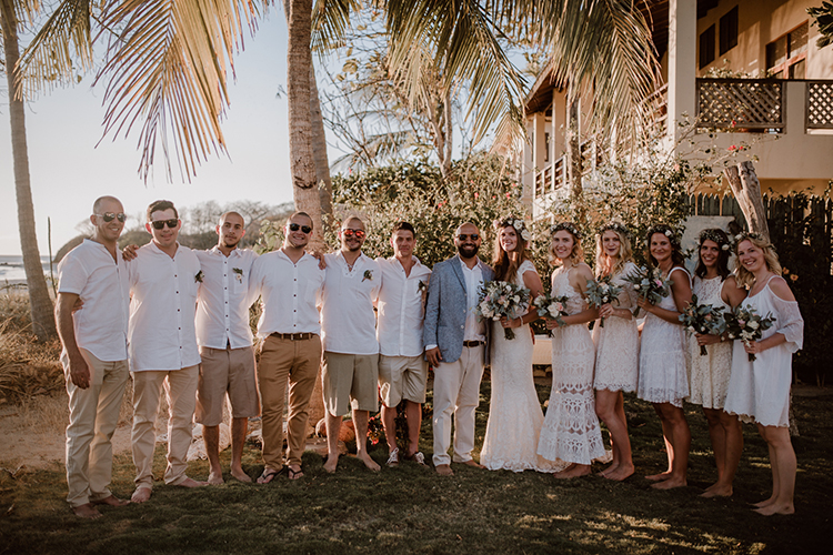 beach wedding parties - https://ruffledblog.com/costa-rica-beach-wedding-with-a-cute-bridesmaid-first-look