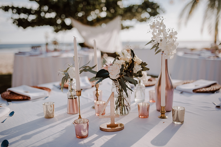 wedding tabletops - https://ruffledblog.com/costa-rica-beach-wedding-with-a-cute-bridesmaid-first-look