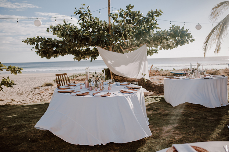 beach wedding receptions - https://ruffledblog.com/costa-rica-beach-wedding-with-a-cute-bridesmaid-first-look