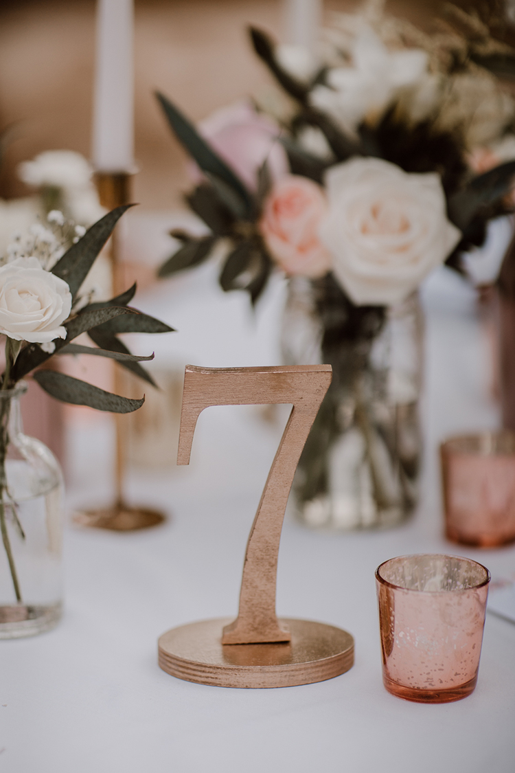 gold table numbers - https://ruffledblog.com/costa-rica-beach-wedding-with-a-cute-bridesmaid-first-look
