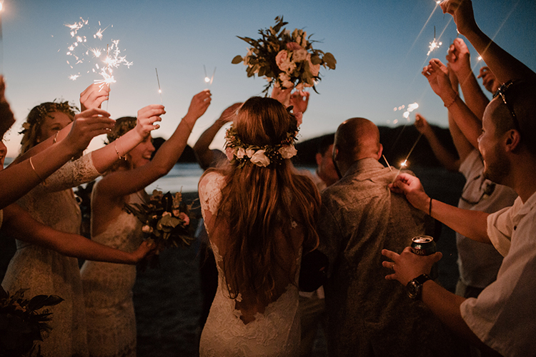 wedding sparklers - https://ruffledblog.com/costa-rica-beach-wedding-with-a-cute-bridesmaid-first-look