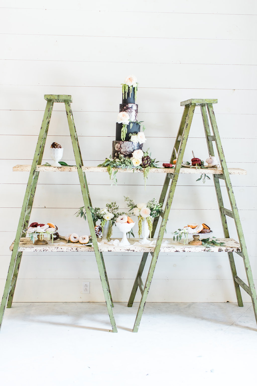 cake table with ladders - photo by Olivia Morgan Photography https://ruffledblog.com/crisp-southern-elegance-makes-for-perfect-wedding-inspiration