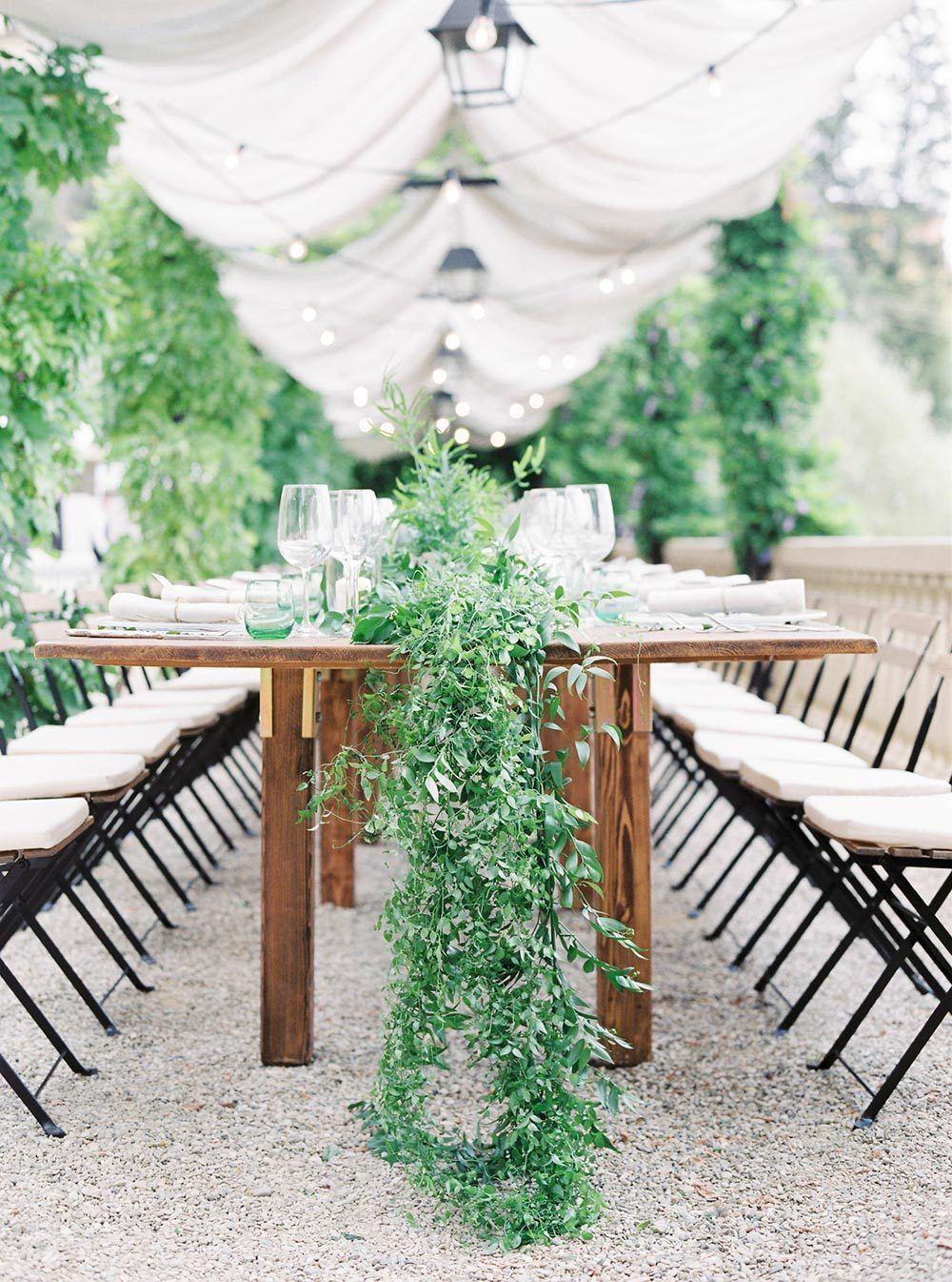 italian villa family style reception table with greenery