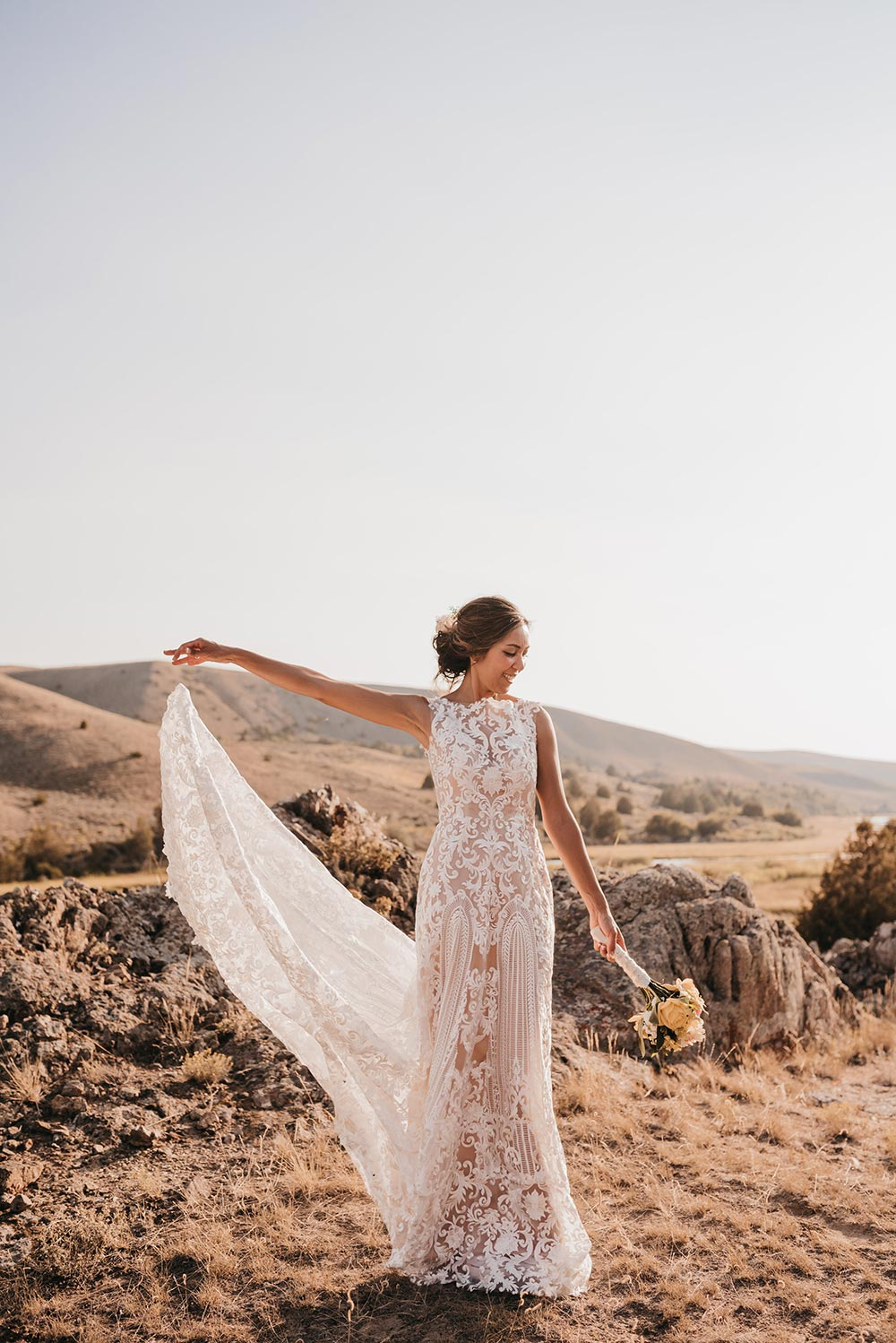 embroidered wedding dress with sleeveless silhouette