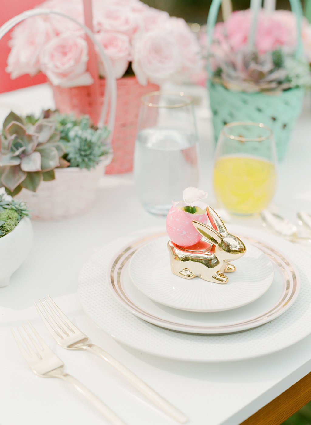 """Easter place settings - photo by The Happy Bloom https://ruffledblog.com/cute-easter-party-inspiration"