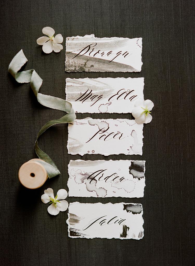 watercolor name cards for weddings - http://ruffledblog.com/dark-and-stormy-magnolia-plantation-wedding-inspiration