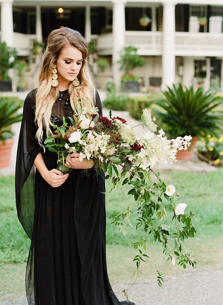 dramatic cascading bouquets - http://ruffledblog.com/dark-and-stormy-magnolia-plantation-wedding-inspiration