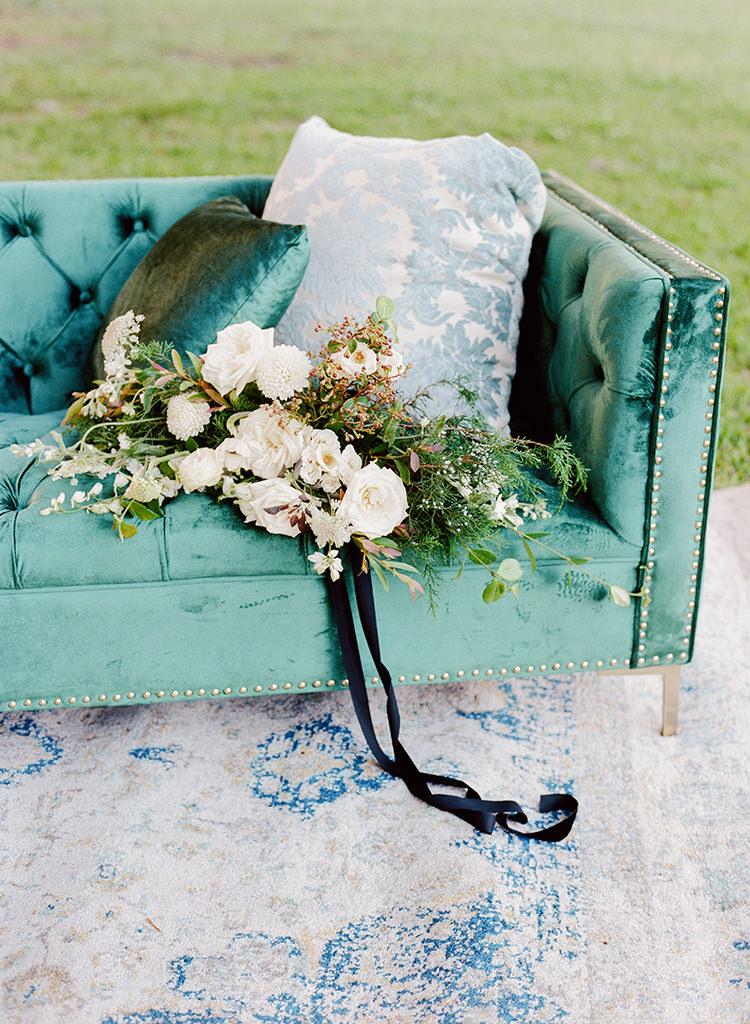 green velvet furniture wedding rentals - http://ruffledblog.com/dark-and-stormy-magnolia-plantation-wedding-inspiration
