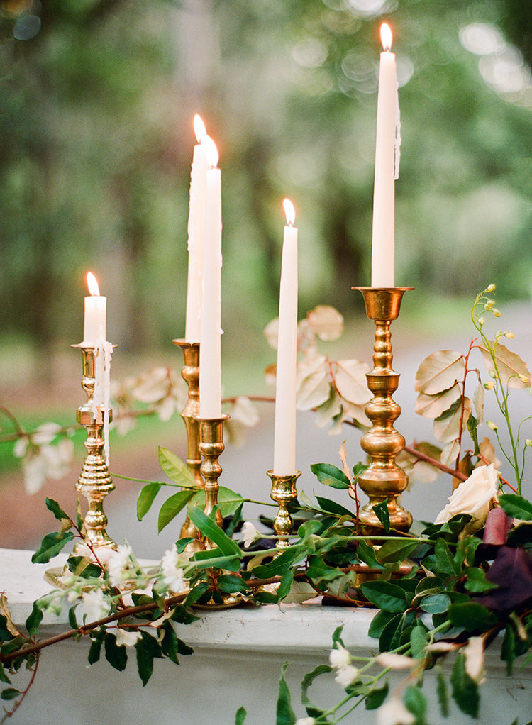 romantic candles at weddings - http://ruffledblog.com/dark-and-stormy-magnolia-plantation-wedding-inspiration
