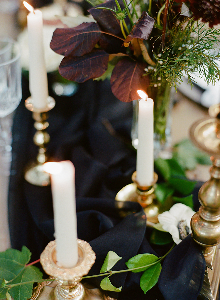 romantic moody tablescapes - http://ruffledblog.com/dark-and-stormy-magnolia-plantation-wedding-inspiration