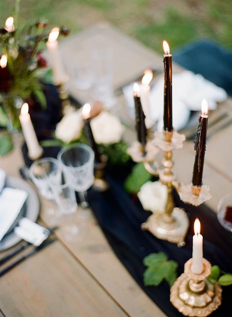 moody fall tablescape ideas - http://ruffledblog.com/dark-and-stormy-magnolia-plantation-wedding-inspiration