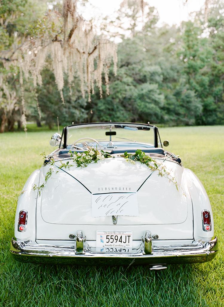 vintage cars for weddings - http://ruffledblog.com/dark-and-stormy-magnolia-plantation-wedding-inspiration
