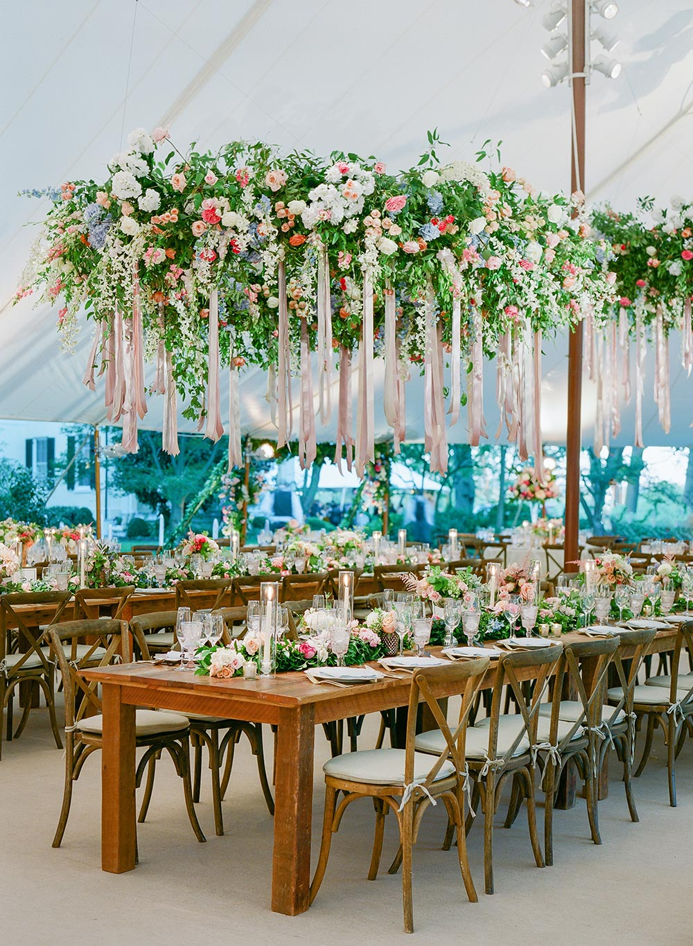 tented wedding reception with flower and ribbon chandeliers