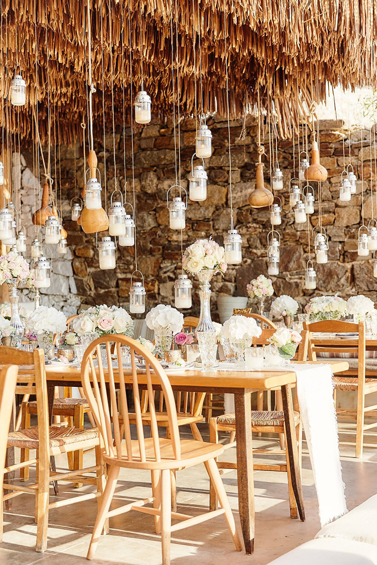 Destination Wedding in Mykonos with Endless Hanging Lanterns - photo by Sotiris Tsakanikas https://ruffledblog.com/destination-wedding-in-mykonos-with-endless-hanging-lanterns