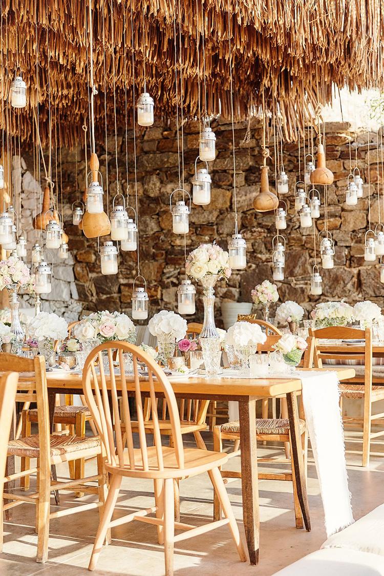 Destination Wedding in Mykonos with Endless Hanging Lanterns - photo by Sotiris Tsakanikas http://ruffledblog.com/destination-wedding-in-mykonos-with-endless-hanging-lanterns