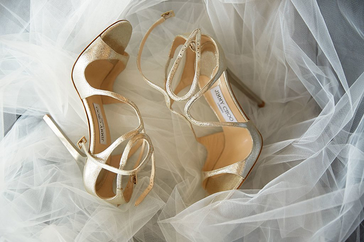 gold wedding shoes - photo by Sotiris Tsakanikas https://ruffledblog.com/destination-wedding-in-mykonos-with-endless-hanging-lanterns