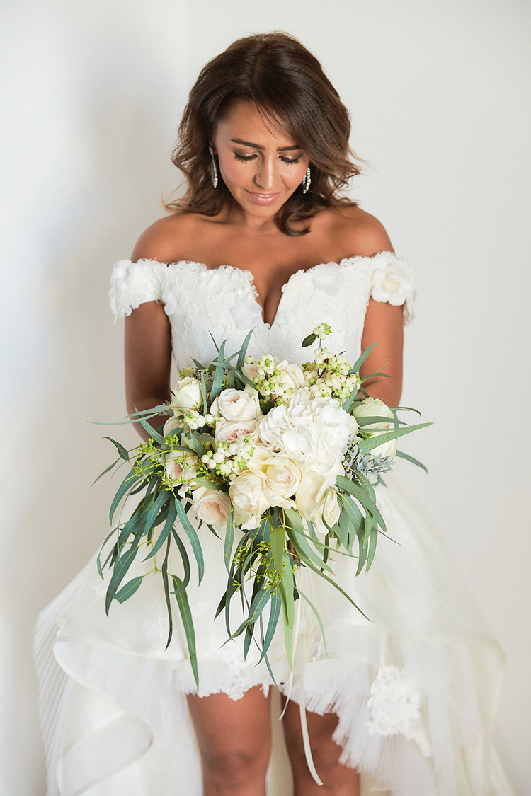 ivory bouquets with eucalyptus - photo by Sotiris Tsakanikas https://ruffledblog.com/destination-wedding-in-mykonos-with-endless-hanging-lanterns