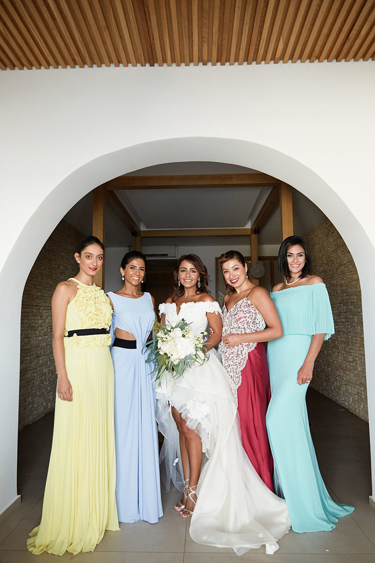 bridesmaids in solid colors - photo by Sotiris Tsakanikas https://ruffledblog.com/destination-wedding-in-mykonos-with-endless-hanging-lanterns