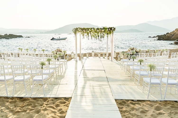 Mykonos beach weddings - photo by Sotiris Tsakanikas https://ruffledblog.com/destination-wedding-in-mykonos-with-endless-hanging-lanterns