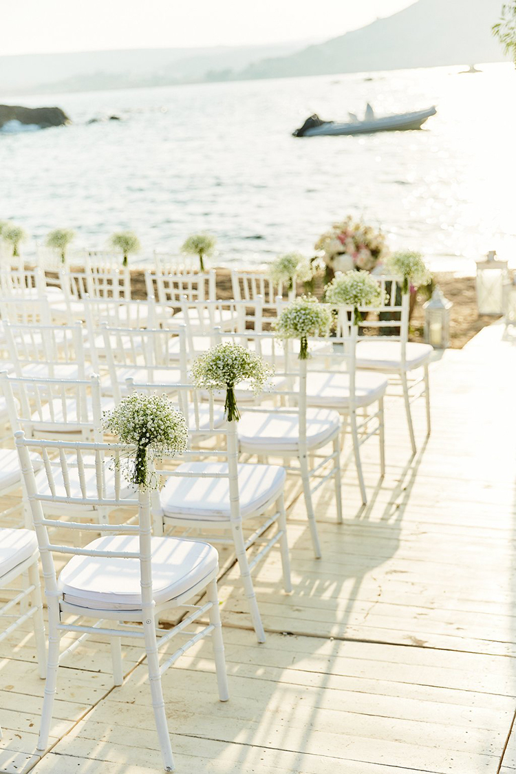 wedding ceremony chairs - photo by Sotiris Tsakanikas https://ruffledblog.com/destination-wedding-in-mykonos-with-endless-hanging-lanterns