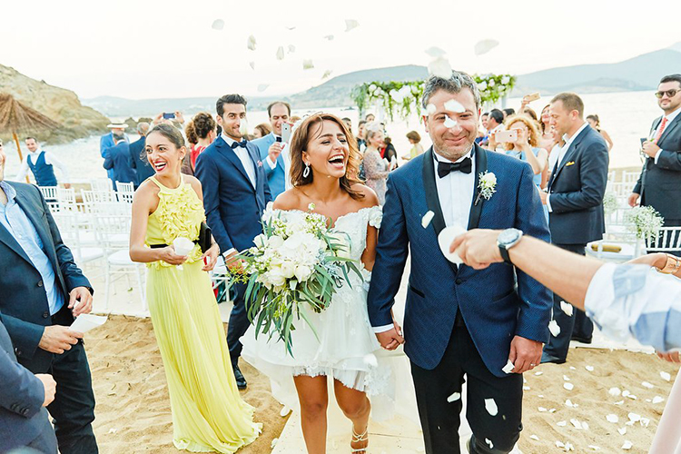 ceremony recessionals - photo by Sotiris Tsakanikas https://ruffledblog.com/destination-wedding-in-mykonos-with-endless-hanging-lanterns