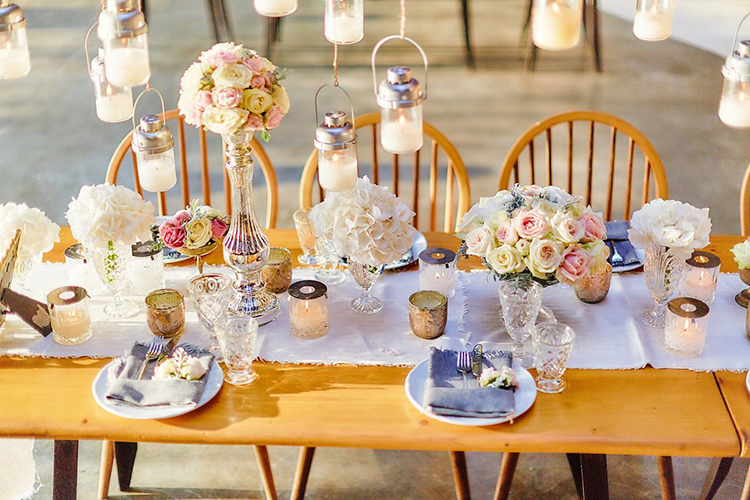 tablescapes with blue runners - photo by Sotiris Tsakanikas https://ruffledblog.com/destination-wedding-in-mykonos-with-endless-hanging-lanterns