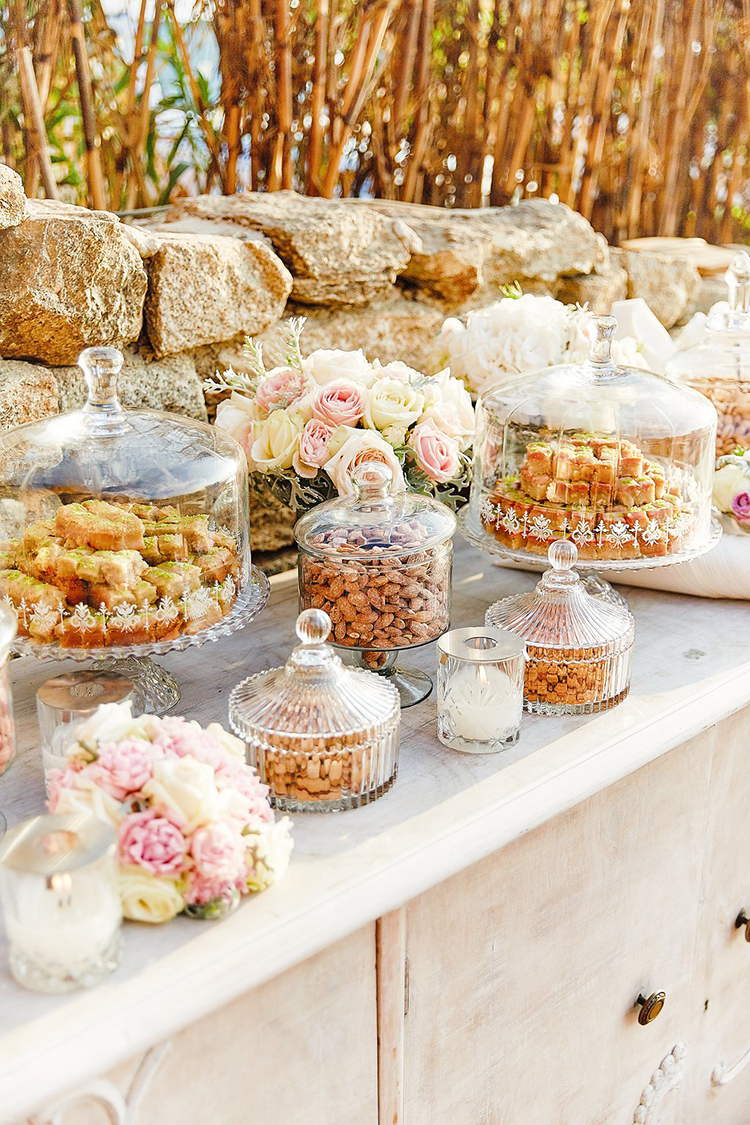 dessert tables - photo by Sotiris Tsakanikas https://ruffledblog.com/destination-wedding-in-mykonos-with-endless-hanging-lanterns