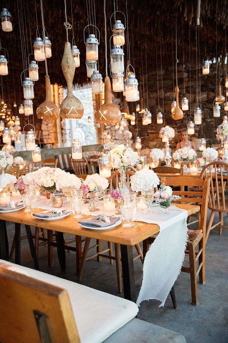 hanging lantern wedding receptions - photo by Sotiris Tsakanikas https://ruffledblog.com/destination-wedding-in-mykonos-with-endless-hanging-lanterns