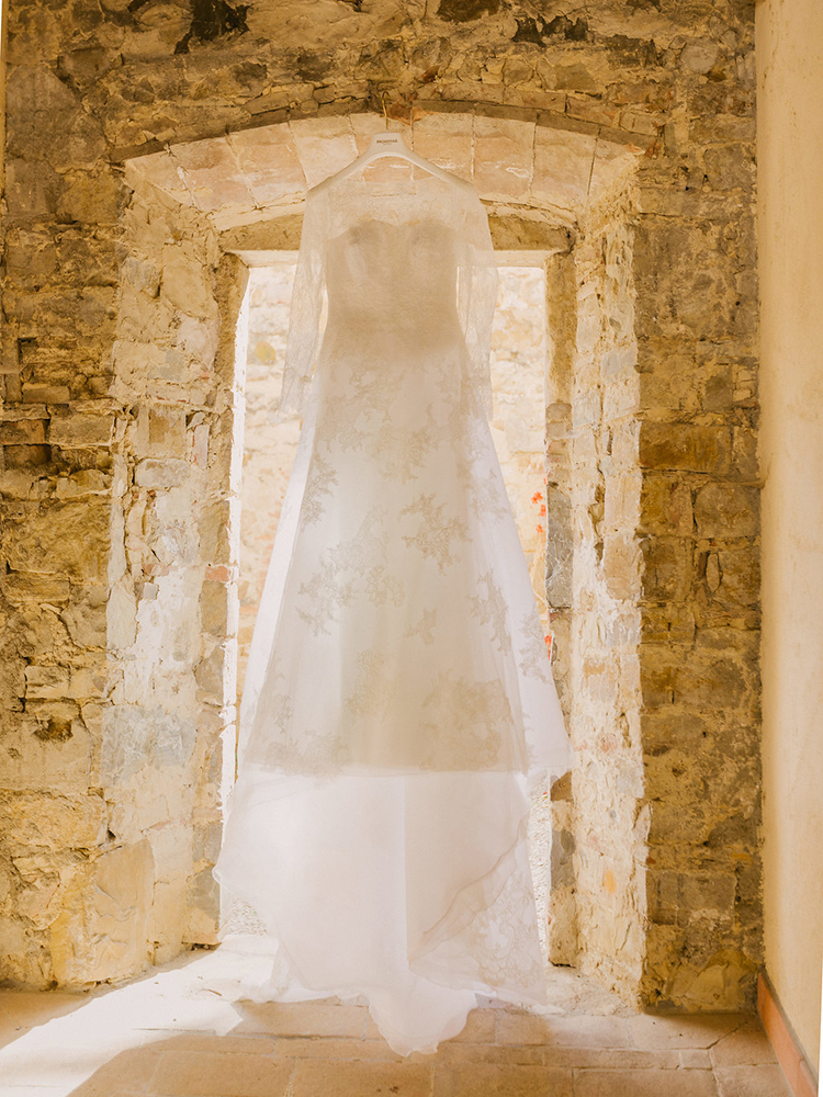 lace wedding dresses - photo by Facibeni Fotografia http://ruffledblog.com/destination-wedding-in-tuscany-with-al-fresco-dining