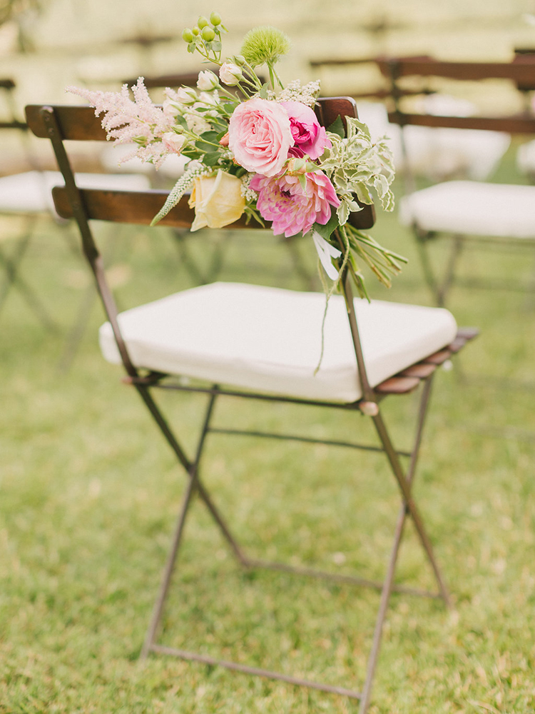 wedding chair decor - photo by Facibeni Fotografia http://ruffledblog.com/destination-wedding-in-tuscany-with-al-fresco-dining