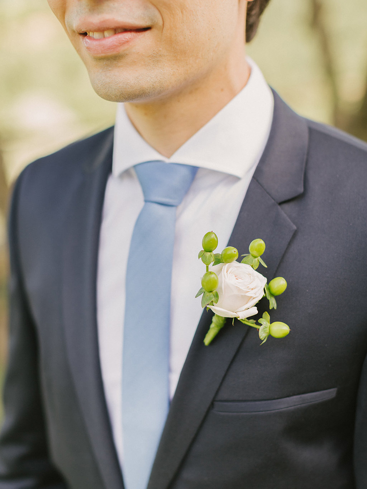 simple grooms boutonniere - photo by Facibeni Fotografia https://ruffledblog.com/destination-wedding-in-tuscany-with-al-fresco-dining