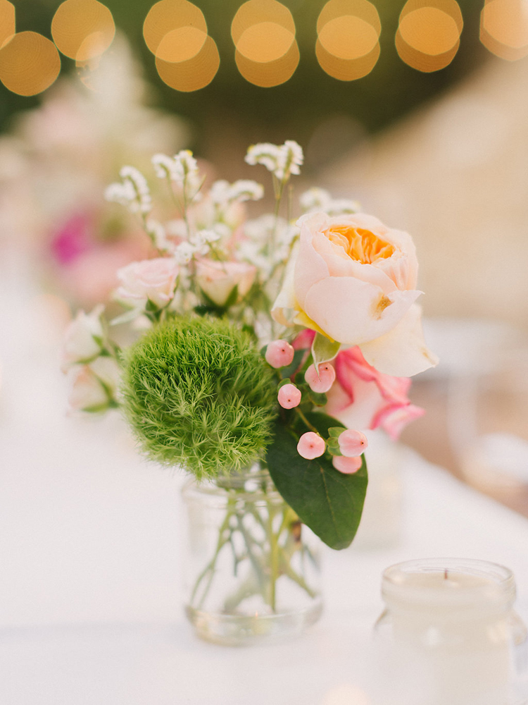 small bud vase centerpiece ideas - photo by Facibeni Fotografia http://ruffledblog.com/destination-wedding-in-tuscany-with-al-fresco-dining