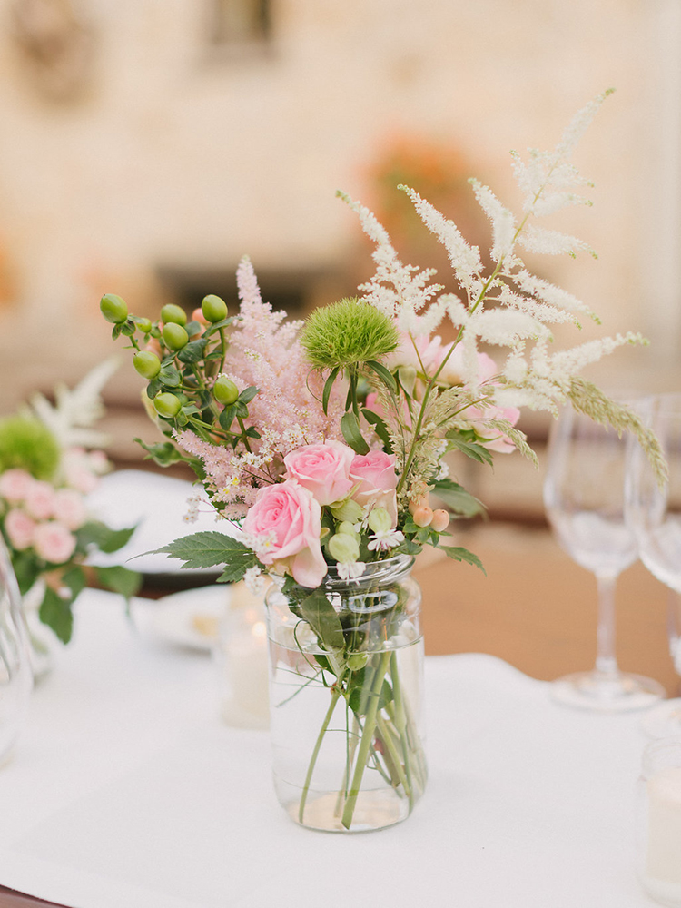 bud vase centerpieces - photo by Facibeni Fotografia http://ruffledblog.com/destination-wedding-in-tuscany-with-al-fresco-dining