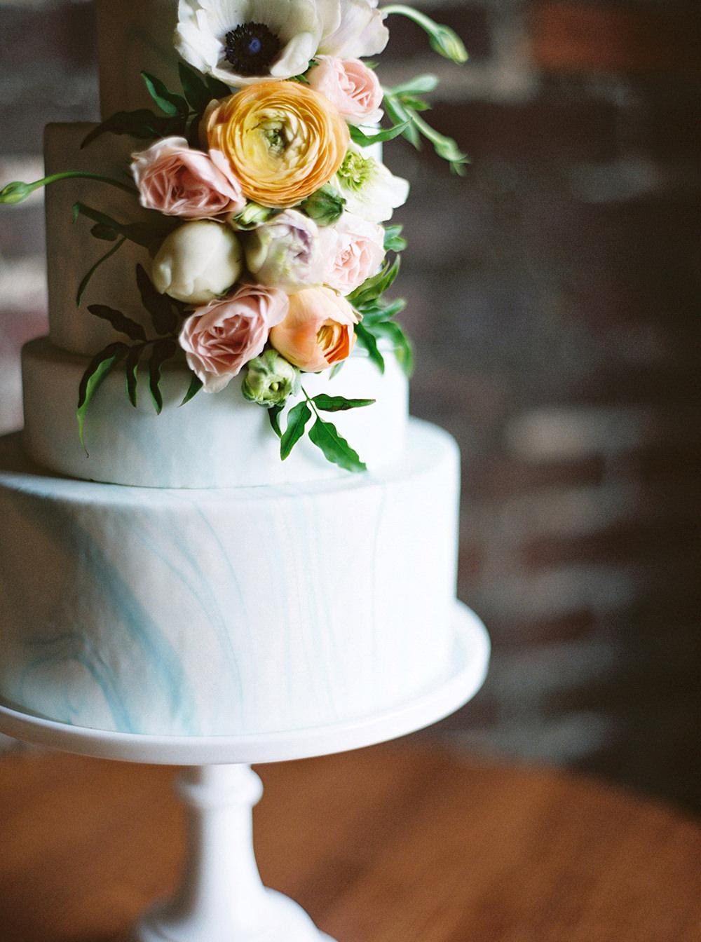 spring wedding cakes - photo by Photos by Heart http://ruffledblog.com/downtown-birmingham-spring-wedding-inspiration