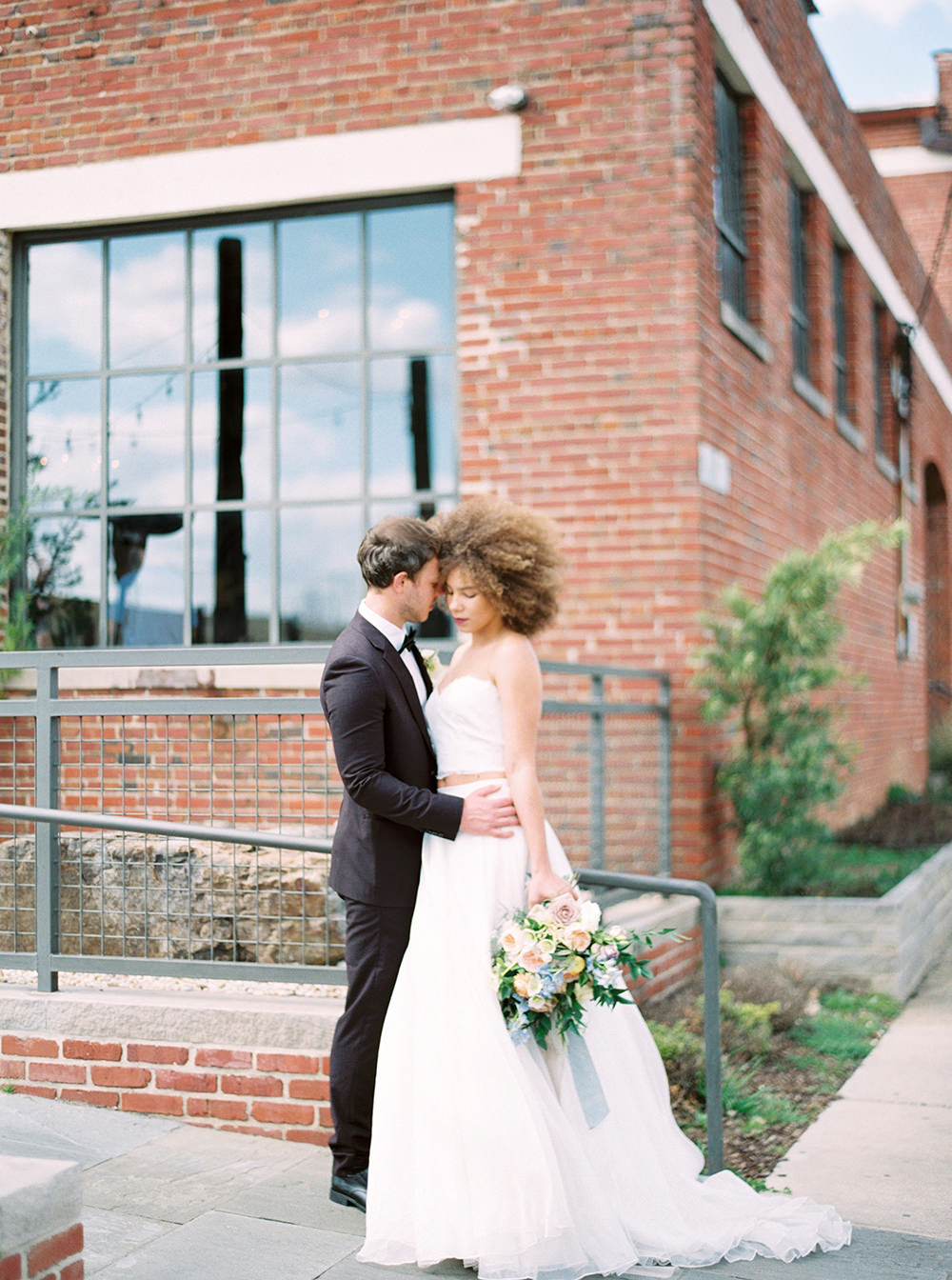 bride and groom - photo by Photos by Heart http://ruffledblog.com/downtown-birmingham-spring-wedding-inspiration